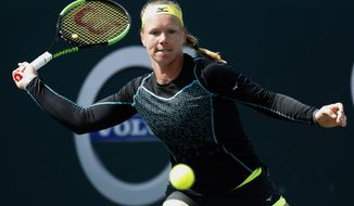 Kiki Bertens, from the Netherlands, returns a shot to Madison Keys during their semifinals match at the Volvo Car Open tennis tournament in Charleston, S.C., Sunday, April 8, 2018. (AP Photo/Mic Smith)