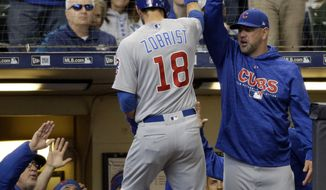 CORRECTS TO FOURTH INNING INNING NOT THIRD INNING - Chicago Cubs' Ben Zobrist (18) gets high-fives after his home run against the Milwaukee Brewers during the fourth inning of a baseball game Sunday, April 8, 2018, in Milwaukee. (AP Photo/Jeffrey Phelps)