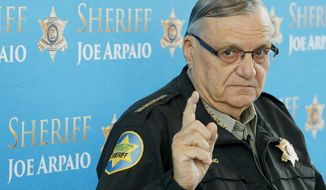FILE - In this Dec. 18, 2013, file photo, Maricopa County Sheriff Joe Arpaio speaks at a news conference in Phoenix, Arizona. Sen. Jeff Flake's son will seek a new civil trial against  then-Sheriff Arpaio for bringing a now-dismissed criminal case against him in the heat-exhaustion deaths of 21 dogs. Austin Flake lost a lawsuit against Arpaio at a trial in December. His attorney says he'll seek another trial because authorities didn't turn over evidence before trial that would have swayed jurors in his client's favor. (AP Photo/Ross D. Franklin, File)