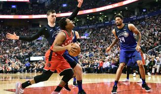 Toronto Raptors guard Kyle Lowry (7) is fouled by Orlando Magic forward Mario Hezonja (8) as Magic center Khem Birch (24) looks on during first half NBA basketball action in Toronto on Sunday, April 8, 2018. (Frank Gunn/The Canadian Press via AP)