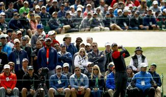 Tiger Woods hits a drive on the third hole during the fourth round at the Masters golf tournament Sunday, April 8, 2018, in Augusta, Ga. (AP Photo/Charlie Riedel)