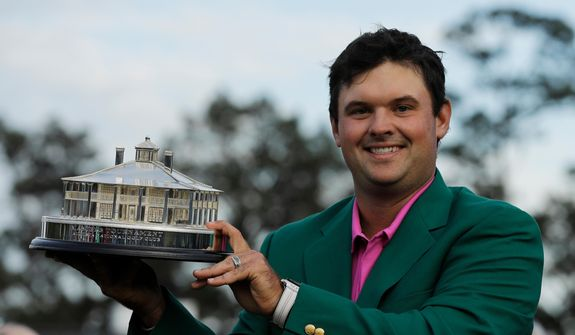 Patrick Reed holds the championship trophy after winning the Masters golf tournament Sunday, April 8, 2018, in Augusta, Ga. (AP Photo/David J. Phillip) **FILE**