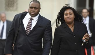 FILE - In this Oct. 17, 2014 file photo, John Jackson and his wife, Carolyn, leave the Federal Courthouse in Newark, N.J., after opening arguments in their trial on charges of child abuse. The former military couple, convicted in July of 2015 of systematically abusing their foster children, will find out on Wednesday, April 11, 2018, if their sentences will be increased. (Chris Pedota/The Record via AP, File)