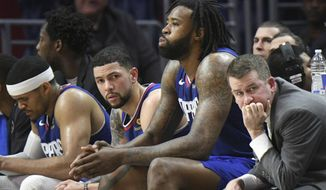 Los Angeles Clippers starters Tobias Harris, Austin Rivers and DeAndre Jordan, from left, sit on the bench with assistant coach Brendan O'Connor near the end of their 134-115 loss to the Denver Nuggets during an NBA basketball game Saturday, April 7, 2018, in Los Angeles. (AP Photo/Michael Owen Baker)