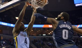 Memphis Grizzlies forward Myke Henry (4) dunks against Detroit Pistons center Andre Drummond (0) in the second half of an NBA basketball game Sunday, April 8, 2018, in Memphis, Tenn. (AP Photo/Brandon Dill)