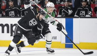 Los Angeles Kings center Tobias Rieder, left, tries to skate past Dallas Stars defenseman Julius Honka during the second period of an NHL hockey game Saturday, April 7, 2018, in Los Angeles. (AP Photo/Kyusung Gong)