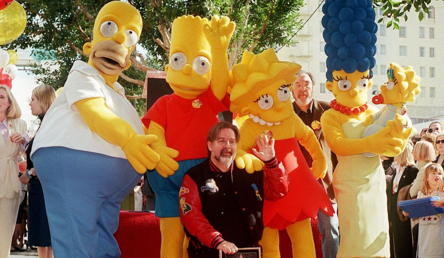 """The Simpsons"" creator Matt Groening is joined by the actors portraying the show's characters in Los Angeles Friday, Jan. 14, 2000, as the longest-running primetime animated series in history was honored with a star on the Hollywood Walk of Fame. (AP Photo/Chris Pizzello) ** FILE **"