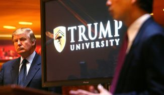 FILE - In this Monday May 23, 2005 file photo, real estate mogul and TV star Donald Trump, left, listens as Michael Sexton introduces him to announce the establishment of Trump University at a press conference in New York. Sexton is president and co-founder of the business education company. (AP Photo/Bebeto Matthews)