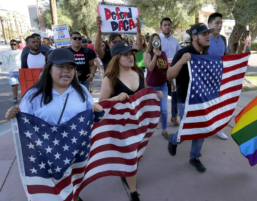 Deferred Action for Childhood Arrivals (DACA) supporters march to the Immigration and Customs Enforcement office to protest shortly after U.S. Attorney General Jeff Sessions' announcement that the Deferred Action for Childhood Arrivals (DACA), will be suspended with a six-month delay, Tuesday, Sept. 5, 2017, in Phoenix. (AP Photo/Matt York) ** FILE **
