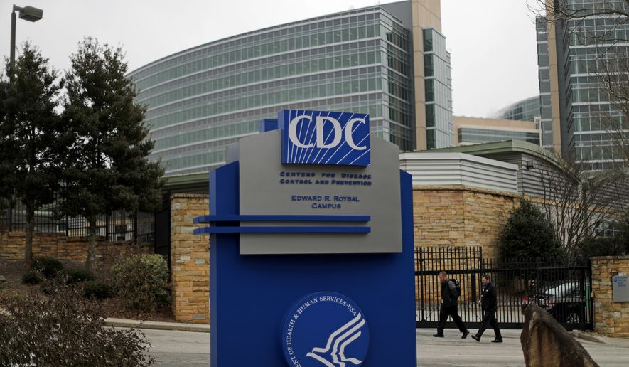 Pedestrians walk past the entrance for the U.S. Centers for Disease Control and Prevention in Atlanta, Monday, Jan. 22, 2018. (AP Photo/David Goldman) ** FILE **