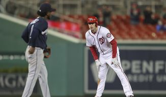Washington Nationals' Max Scherzer, right, stands up after stealing second base in the seventh inning of a baseball game against Atlanta Braves at Nationals Park, Monday, April 9, 2018, in Washington. Braves second baseman Ozzie Albies (1) looks on. (AP Photo/Pablo Martinez Monsivais)
