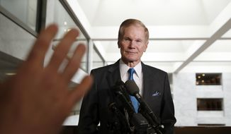 Sen. Bill Nelson, D-Fla., the ranking member of the Senate Commerce Committee, listens to a question after a meeting with Facebook CEO Mark Zuckerberg on Capitol Hill, Monday, April 9, 2018, in Washington. Zuckerberg will testify Tuesday before a joint hearing of the Commerce and Judiciary Committees about the use of Facebook data to target American voters in the 2016 election. (AP Photo/Alex Brandon)