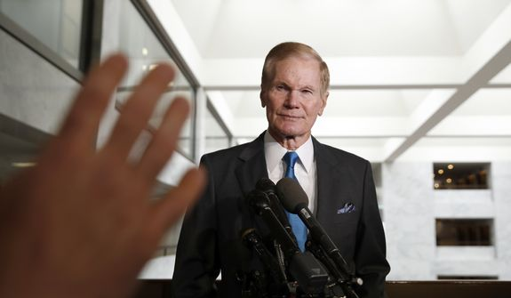 Sen. Bill Nelson, D-Fla., the ranking member of the Senate Commerce Committee, listens to a question after a meeting with Facebook CEO Mark Zuckerberg on Capitol Hill, Monday, April 9, 2018, in Washington. (AP Photo/Alex Brandon)
