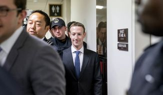 Facebook CEO Mark Zuckerberg leaves a meeting on Capitol Hill in Washington, Monday, April 9, 2018. Zuckerberg will testify Tuesday before a joint hearing of the Commerce and Judiciary Committees about the use of Facebook data to target American voters in the 2016 election. (AP Photo/Andrew Harnik)