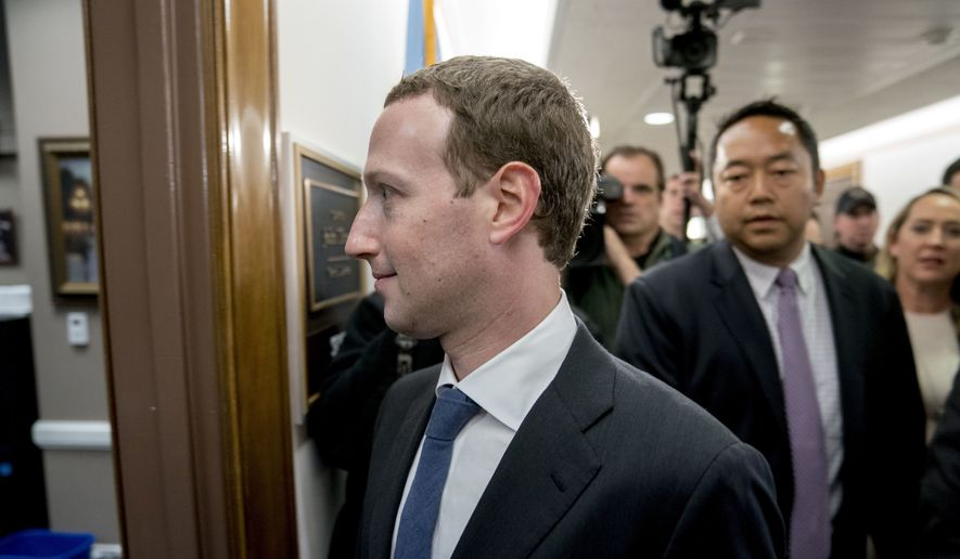 Facebook CEO Mark Zuckerberg arrives for a meeting with Sen. John Thune, R-S.D., on Capitol Hill in Washington, Monday, April 9, 2018. Zuckerberg will testify Tuesday before a joint hearing of the Commerce and Judiciary Committees about the use of Facebook data to target American voters in the 2016 election. (AP Photo/Andrew Harnik)