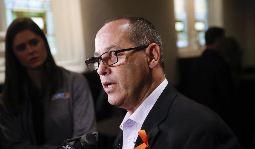 Fred Guttenberg, father of 14-year-old student Jaime who was killed in a mass shooting at Marjory Stoneman High School in Parkland, Fla., speaks to the media at a Hamilton County Young Democrats event to advocate for stronger gun legislation, Monday, April 9, 2018, in Cincinnati. (AP Photo/John Minchillo)