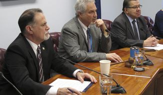 Three members of the Alaska Senate majority's leadership listen to questions during the majority's weekly news conference on Monday, April 9, 2018, in Juneau, Alaska. Pictured are, from left, Senate Majority Leader Peter Micciche, Senate President Pete Kelly and Senate Finance Committee Co-chair Lyman Hoffman. (AP Photo/Becky Bohrer)