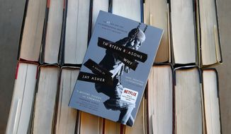 "FILE - This Monday, May 15, 2017, file photo illustration shows the book ""Thirteen Reasons Why"" in Phoenix. Jay Asher's ""Thirteen Reasons Why"" and Sherman Alexie's ""The Absolutely True Diary of a Part-Time Indian"" top the American Library Association's list of ""challenged"" books from 2017, those most objected to by parents and other community members. (AP Photo/Ross D. Franklin, File)"