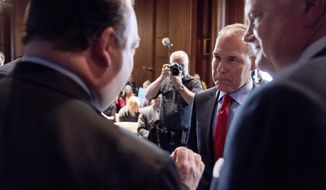 Environmental Protection Agency Administrator Scott Pruitt speaks with auto industry leaders following a news conference at the Environmental Protection Agency in Washington, Tuesday, April 3, 2018, on his decision to scrap Obama administration fuel standards. (AP Photo/Andrew Harnik)