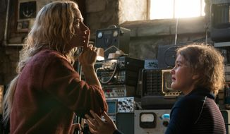 "This image released by Paramount Pictures shows Emily Blunt, left, and Millicent Simmonds in a scene from ""A Quiet Place."" (Jonny Cournoyer/Paramount Pictures via AP)"