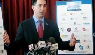 FILE - In this Jan. 30, 2018, file photo, Wisconsin Gov. Scott Walker speaks at a news conference in Madison, Wis. The Republican Governors Association announced Monday, April 9, 2018, it has booked $5.1 million worth of television advertising time in Wisconsin for the five weeks leading up to the Nov. 6 election. Walker is running for a third term this year. (AP Photo/Scott Bauer, File)