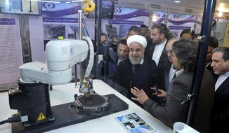 "In this photo released by an official website of the office of the Iranian Presidency, President Hassan Rouhani listens to explanations on new nuclear achievements at a ceremony to mark ""National Nuclear Day,"" in Tehran, Iran, Monday, April 9, 2018. Rouhani said Monday that despite many attempts, the U.S. has ""failed to destroy"" the landmark 2015 deal between Iran and world powers. (Iranian Presidency Office via AP)"