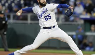 Kansas City Royals starting pitcher Jakob Junis delivers to a Seattle Mariners batter during the first inning of a baseball game against the Kansas City Royals at Kauffman Stadium in Kansas City, Mo., Monday, April 9, 2018. (AP Photo/Orlin Wagner)