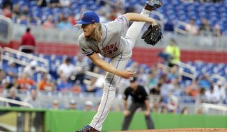 New York Mets starting pitcher Noah Syndergaard follows through on a delivery during the first inning of a baseball game against the Miami Marlins, Monday, April 9, 2018, in Miami. (AP Photo/Lynne Sladky)