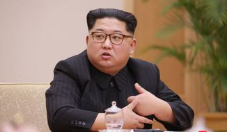 """In this April 9, 2018, photo provided by the North Korean government, North Korean leader Kim Jong Un attends a meeting  of the Political Bureau of the Central Committee of the Workers' Party of Korea, in Pyongyang, North Korea. Independent journalists were not given access to cover the event depicted in this image distributed by the North Korean government. The content of this image is as provided and cannot be independently verified. Korean language watermark on image as provided by source reads: """"KCNA"""" which is the abbreviation for Korean Central News Agency. (Korean Central News Agency/Korea News Service via AP)"""