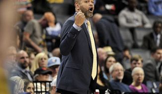 Memphis Grizzlies interim head coach J.B. Bickerstaff calls to players in the first half of an NBA basketball game against the Detroit Pistons, Sunday, April 8, 2018, in Memphis, Tenn. (AP Photo/Brandon Dill)
