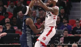 Toronto Raptors guard Lorenzo Brown (4) passes as Detroit Pistons guard Langston Galloway (9) defends during the first half of an NBA basketball game, Monday, April 9, 2018, in Detroit. (AP Photo/Carlos Osorio)