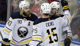 Buffalo Sabres' Sam Reinhart (23) celebrates with Ryan O'Reilly (90) and Jack Eichel 915) after scoring a goal during the third period of an NHL hockey game against the Florida Panthers, Saturday, April 7, 2018, in Sunrise, Fla. The Panthers won 4-3. (AP Photo/Lynne Sladky)