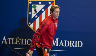 FILE - In this April 26, 2016 file photo, Atletico Madrid's Fernando Torres leaves a news conference at the Vicente Calderon stadium in Madrid, Spain. Striker Fernando Torres said on Monday April 9, 2018, that he will leave Atletico Madrid at the end of this season, to make way for others at the club. (AP Photo/Paul White, file)