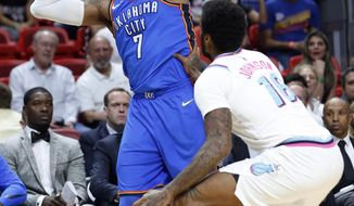 Oklahoma City Thunder forward Carmelo Anthony (7) looks for an open teammate past Miami Heat forward James Johnson (16) during the first half of an NBA basketball game, Monday, April 9, 2018, in Miami. (AP Photo/Wilfredo Lee)