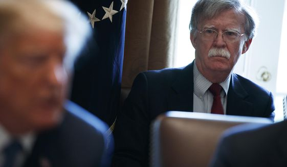 National security adviser John Bolton listens as President Donald Trump speaks during a cabinet meeting at the White House in Washington on April 9, 2018. (Associated Press) **FILE**