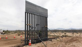 Bollard fencing uses poles 18 feet or taller lined side by side with small gaps in between. Those gaps are crucial for visibility into Mexico, Border Patrol agents say, giving them the chance to spot ambushes. (Associated Press/File)