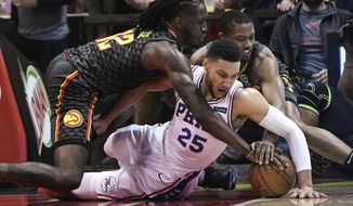 Philadelphia 76ers guard Ben Simmons (25) Atlanta Hawks forward Taurean Prince left, and guard Isaiah Taylor vie for a loose ball during the first half of an NBA basketball game Tuesday, April 10, 2018, in Atlanta. (AP Photo/John Amis)
