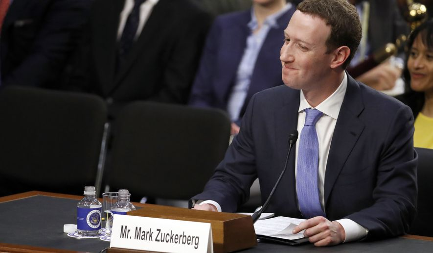 Facebook CEO Mark Zuckerberg reacts to a question about the hotel he stayed in last night as he testifies before a joint hearing of the Commerce and Judiciary Committees on Capitol Hill in Washington, Tuesday, April 10, 2018, about the use of Facebook data to target American voters in the 2016 election. (AP Photo/Alex Brandon)