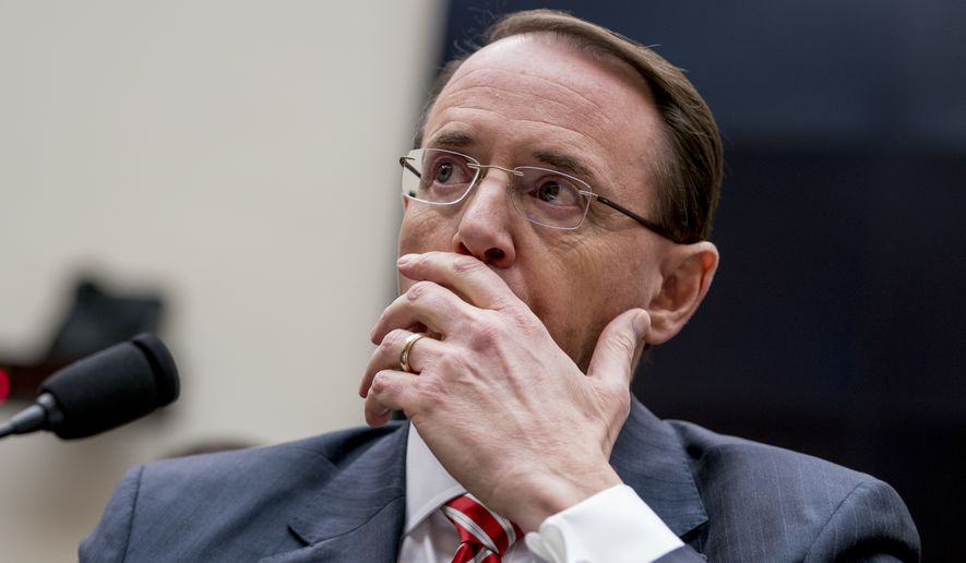 "Deputy Attorney General Rod Rosenstein pauses while testifying before a House Committee on the Judiciary oversight hearing on Capitol Hill, Wednesday, Dec. 13, 2017 in Washington. Two FBI officials who would later be assigned to the special counsel's investigation into Donald Trump's presidential campaign described him with insults like ""idiot"" and ""loathsome human"" in a series of text messages last year, according to copies of the messages released Tuesday. (AP Photo/Andrew Harnik)"