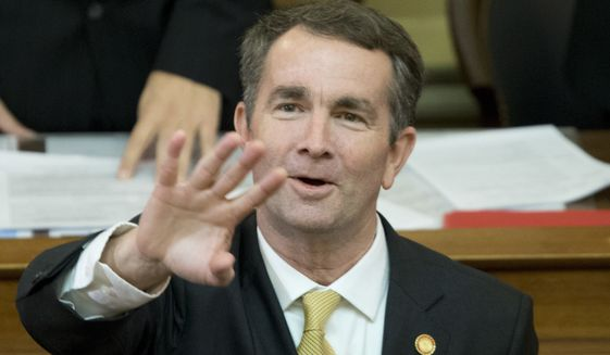 Virginia Gov. Ralph Northam waves to the gallery as he prepares to deliver his State of the Commonwealth address before a joint session of the Virginia General Assembly at the Capitol in Richmond, Va., Monday, Jan. 15, 2018. (AP Photo/Steve Helber) ** FILE **