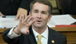 Virginia Gov. Ralph Northam waves to the gallery as he prepares to deliver his State of the Commonwealth address before a joint session of the Virginia General Assembly at the Capitol in Richmond, Va., Monday, Jan. 15, 2018. (AP Photo/Steve Helber)