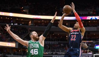 Washington Wizards forward Otto Porter Jr. (22) shoots against Boston Celtics center Aron Baynes (46) during the first half of an NBA basketball game Tuesday, April 10, 2018, in Washington. (AP Photo/Nick Wass) ** FILE **