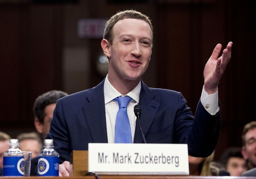 Facebook CEO Mark Zuckerberg testifies before a joint hearing of the Commerce and Judiciary Committees on Capitol Hill in Washington, Tuesday, April 10, 2018, about the use of Facebook data to target American voters in the 2016 election. (AP Photo/Andrew Harnik)