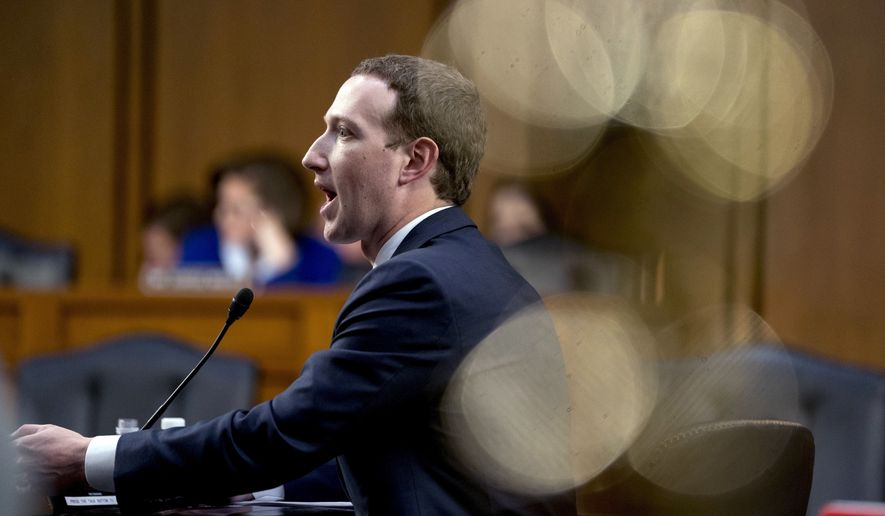 Facebook CEO Mark Zuckerberg testified before a joint hearing of the Commerce and Judiciary Committees on Capitol Hill on Tuesday. (Associated Press)