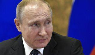 Russian President Vladimir Putin attends a meeting in the Kurchatov Institute of Atomic Energy, the home of the Soviet nuclear weapons program and later Soviet and Russian non-military nuclear technologies, in Moscow, Russia, Tuesday, April 10, 2018. (Alexei Nikolsky, Sputnik, Kremlin Pool Photo via AP)