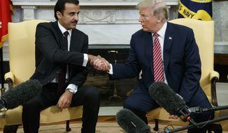 President Donald Trump shakes hands with Emir of Qatar Sheikh Tamim bin Hamad al-Thani in the Oval Office of the White House, Tuesday, April 10, 2018, in Washington. (AP Photo/Evan Vucci)