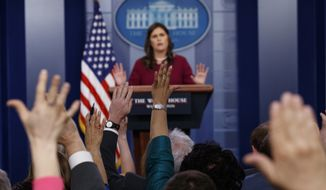 Journalists raise their hands to ask a question as White House press secretary Sarah Huckabee Sanders speaks during the daily press briefing at the White House, Tuesday, April 10, 2018, in Washington. (AP Photo/Evan Vucci)