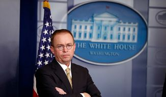 In this Jan. 20, 2018, file photo, Director of the Office of Management and Budget Mick Mulvaney stands during a press briefing at the White House in Washington.  (AP Photo/Alex Brandon, File) **FILE**