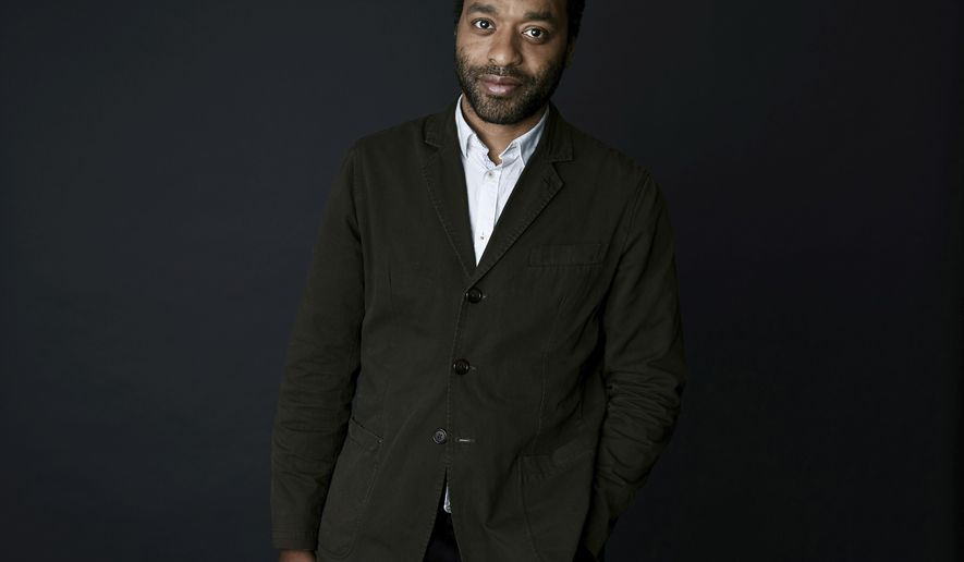 """ADDS LOCATION - In this March 28, 2018 photo, Chiwetel Ejiofor poses for a portrait in New York to promote his Netflix series, """"Come Sunday,"""" debuting on April 13. (Photo by Taylor Jewell/Invision/AP)"""
