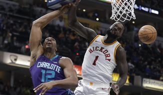 Indiana Pacers' Lance Stephenson (1) blocks the shot of Charlotte Hornets' Dwight Howard during the first half of an NBA basketball game Tuesday, April 10, 2018, in Indianapolis. (AP Photo/Darron Cummings)